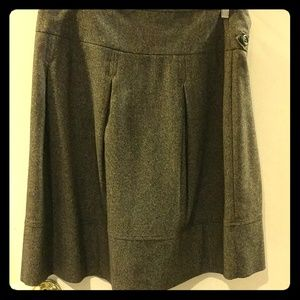 Pleated midi length brown wool skirt